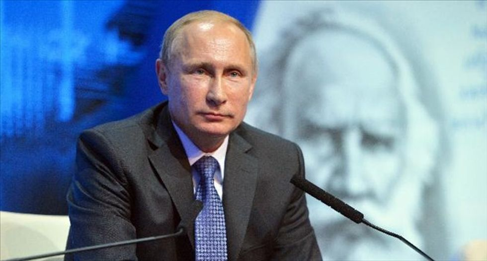 Vladimir Putin accuses Obama of 'attempts to blackmail' Russia