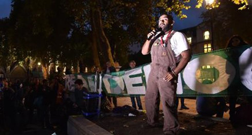Protesters stage 'Occupy' protest of British parliament, plan to set up camp