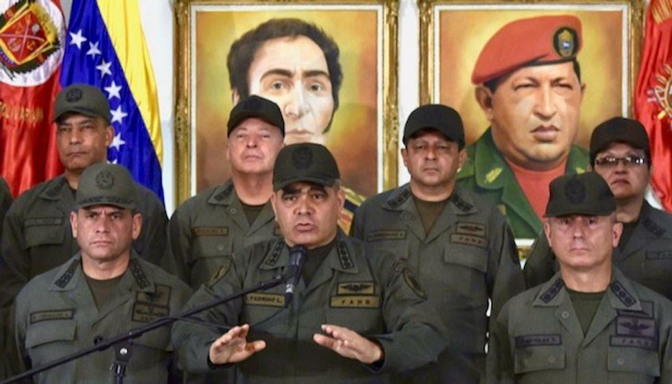 Venezuela military backs Maduro, on 'alert' for border violations