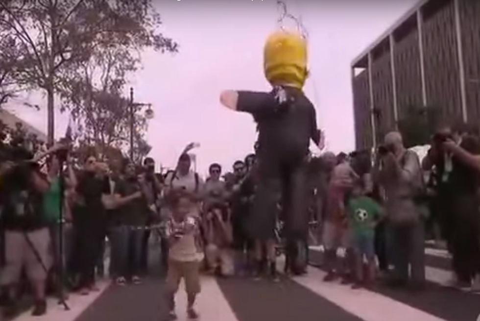 WATCH: Kids at protest whack Donald Trump piñata
