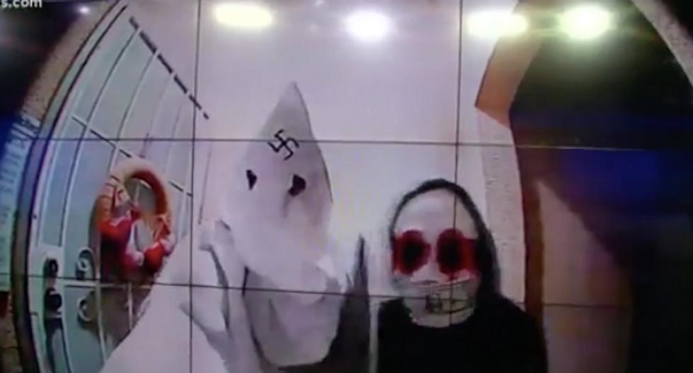 Shocking door cam video shows man in KKK hood with swastika on it
