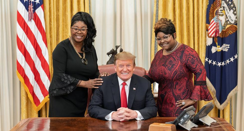 Trump isn't managing the coronavirus crisis or anything else – He just spent an hour in the White House with Diamond & Silk