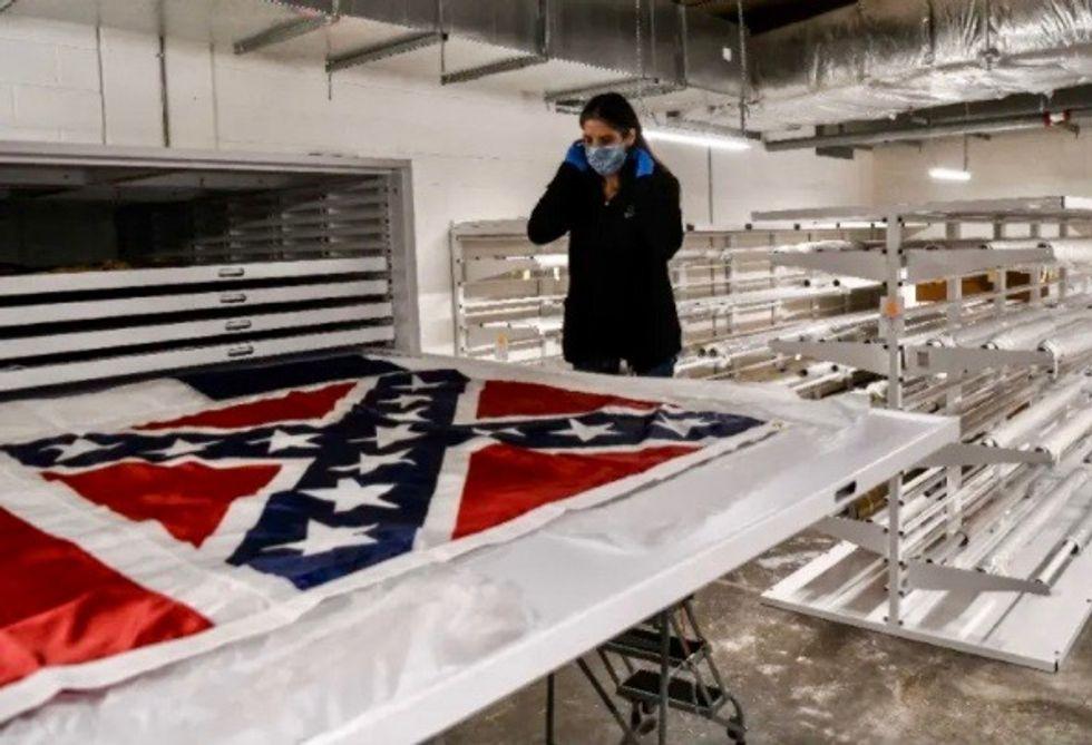 Mississippi voters back new flag without Confederate emblem