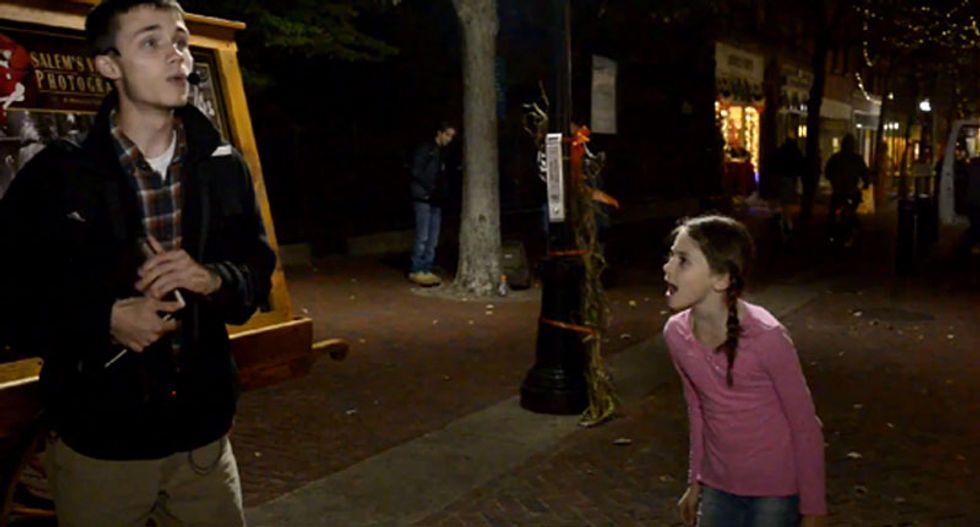 'Jesus, blah, blah!' Watch this sassy little girl tell a street preacher to shut his piehole