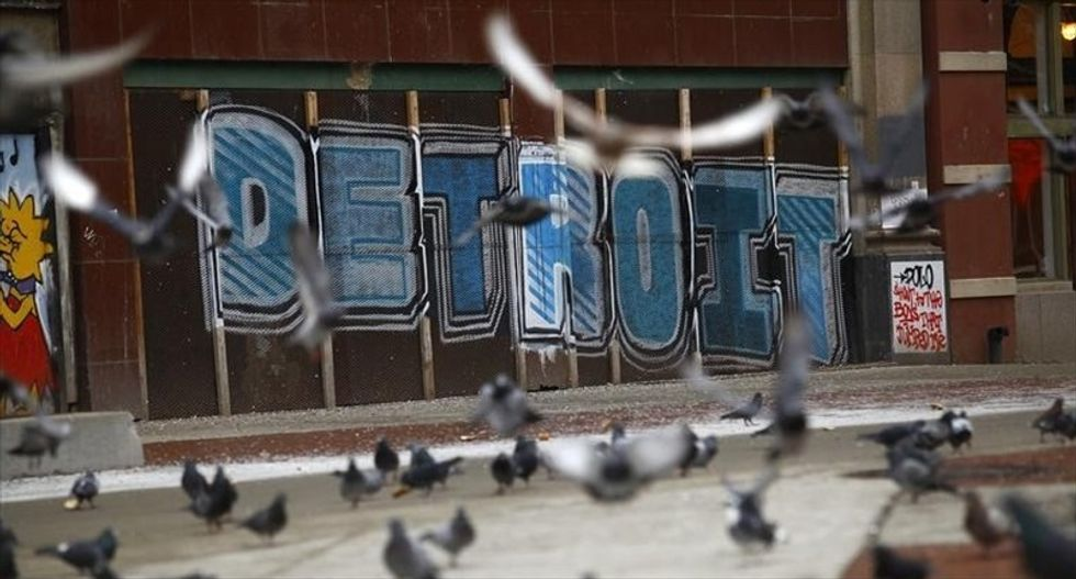 Detroit wins court approval for plan to exit bankruptcy