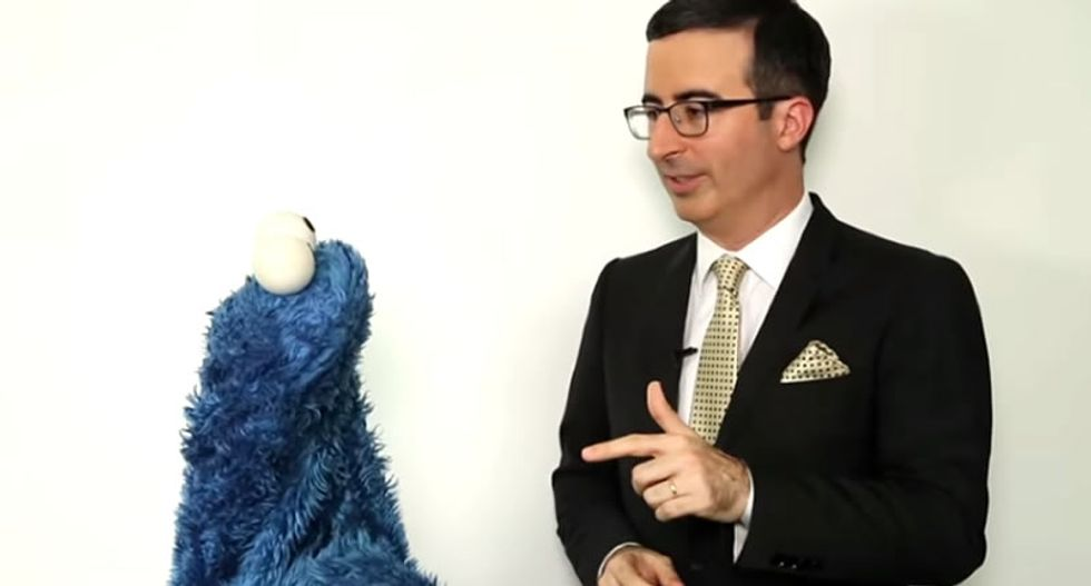 WATCH: John Oliver shares the harsh facts of life in Britain with Cookie Monster