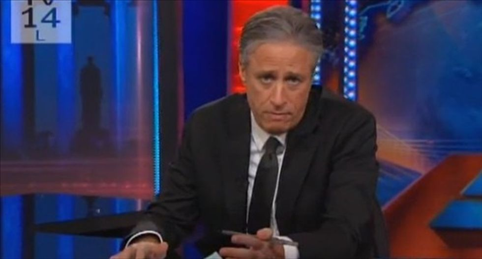 Jon Stewart gives a one-finger salute to the cops behind the Minneapolis 'Pointergate' fiasco