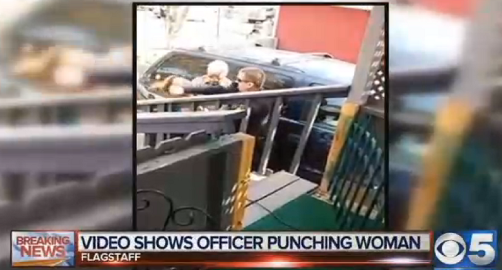 Arizona officer who punched woman is put on leave as probes begin