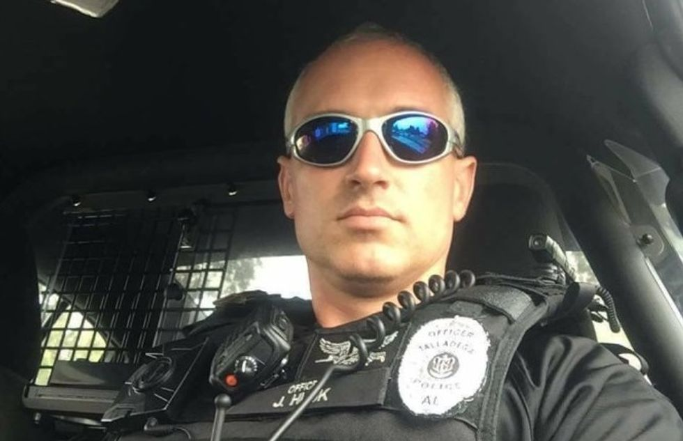 Trump-loving cop fired over racist Facebook posts about Michelle Obama's fluency in 'ghetto'