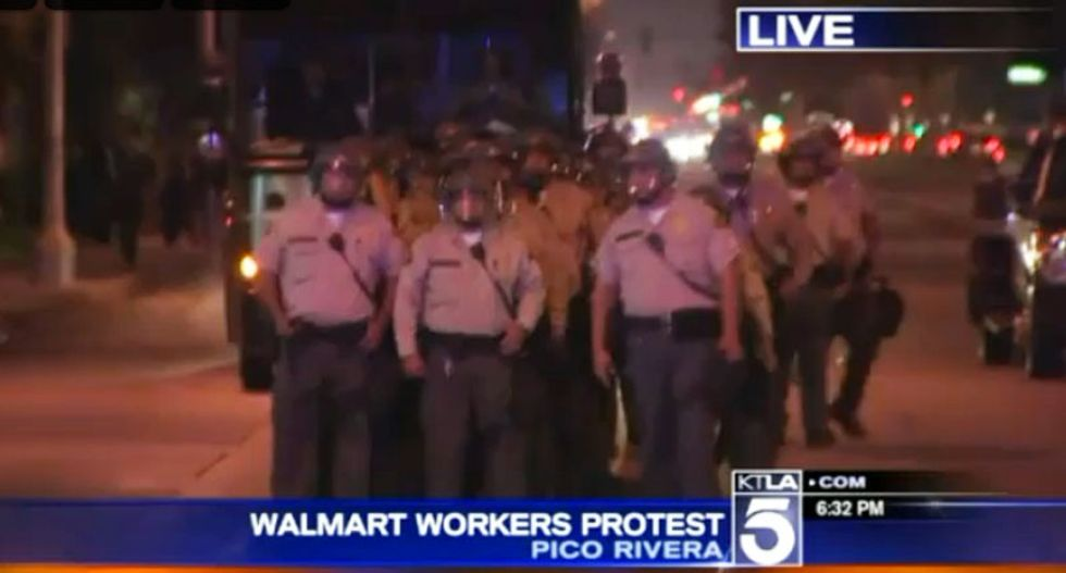 WATCH: Police in riot gear arrest California Walmart workers during sit-in over wages, firings