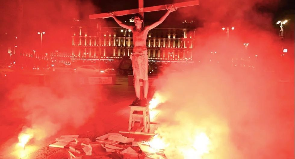 Russian activist jailed for 15 days over crucifixion stunt