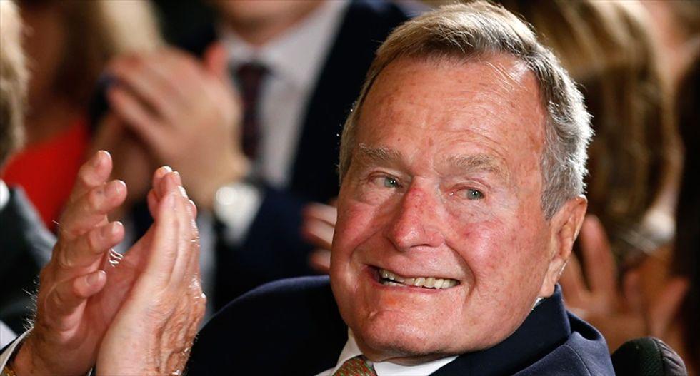Former U.S. President George H.W. Bush remains hospitalized