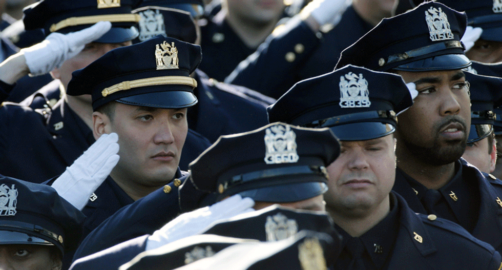 Thousands gather for slain New York police officer's funeral