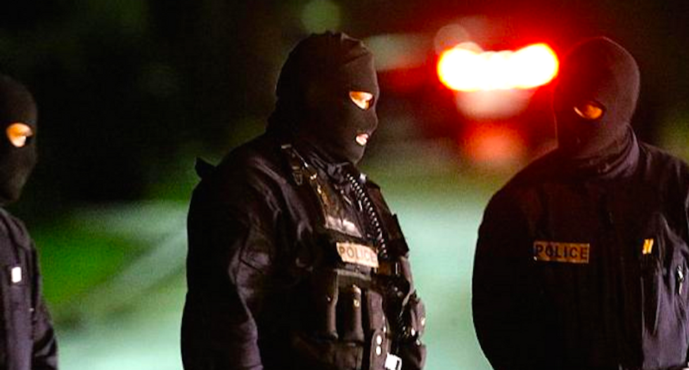 Paris massacre suspects cornered with hostage as 'Robocop' police close in