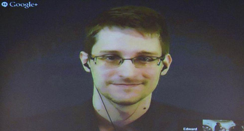Edward Snowden draws crowd with Twitter debut