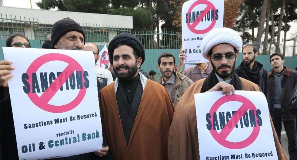 Senators unveil more toned down Iran sanctions bill