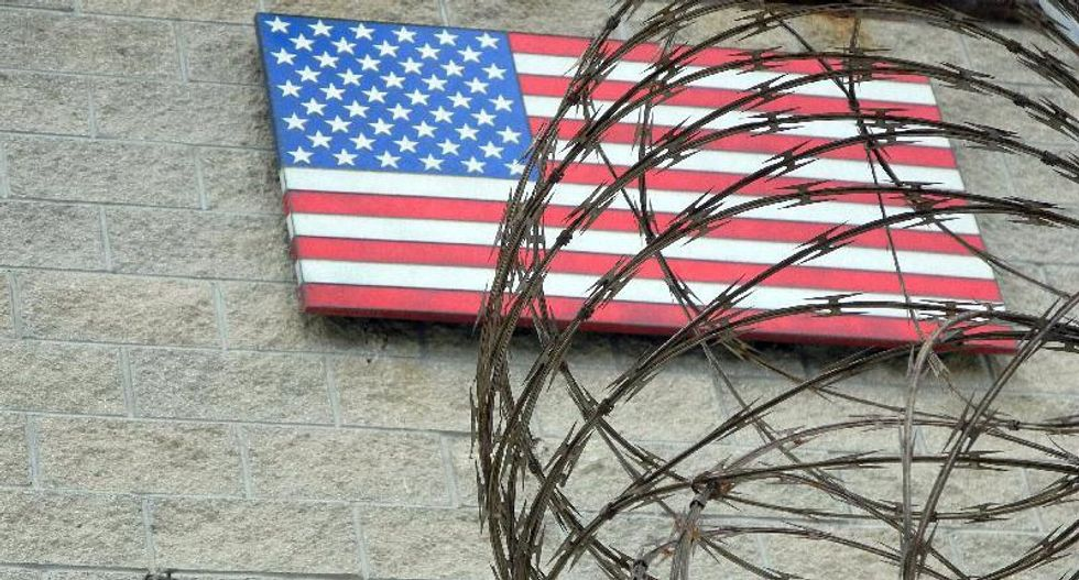 Another prisoner leaves Guantanamo as officials deny stalling on shutting it down