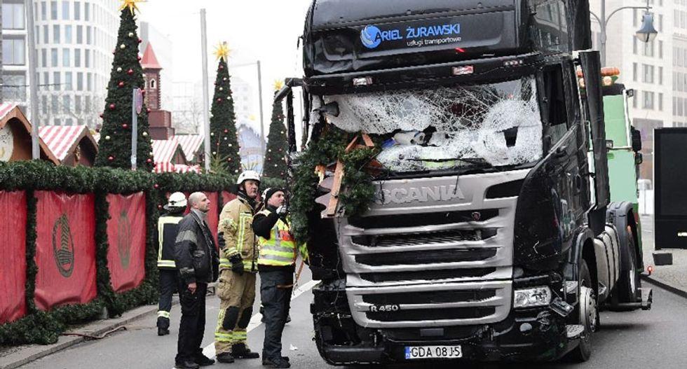 Merkel: Asylum seeker being held over Berlin Christmas market carnage