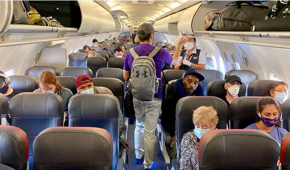 Low risk of COVID-19 infection on planes if masks worn: US military