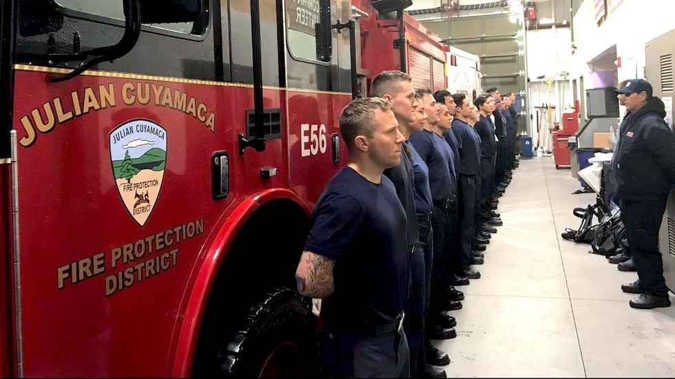 Volunteer firefighters barricade themselves in fire station and refuse to leave after being disbanded