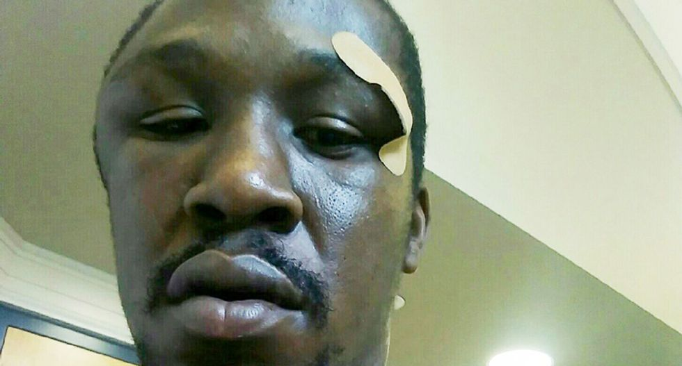 WATCH: Body-cam video shows North Carolina cop restraining black man as his partner beats him for jaywalking