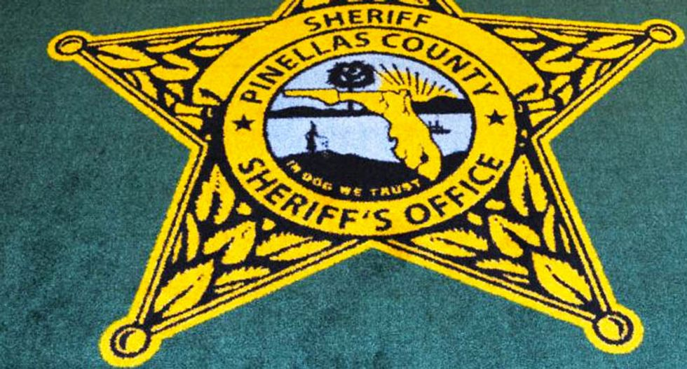 Florida sheriff fetches thousands in bids for goofed-up 'In Dog we trust' rug