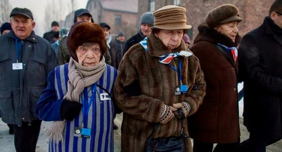 Dozens of survivors pay homage to victims of Auschwitz