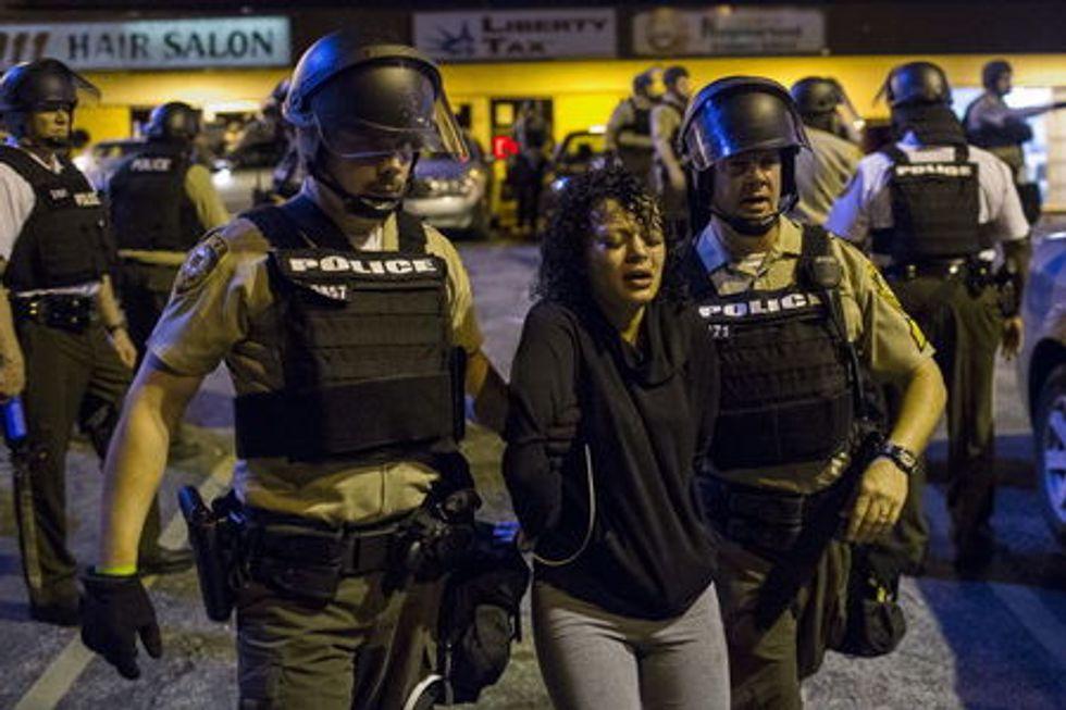 St Louis County police officers arrest an anti-police demonstrator in Ferguson, Missouri August 11, 2015.  REUTERS/Lucas Jackson