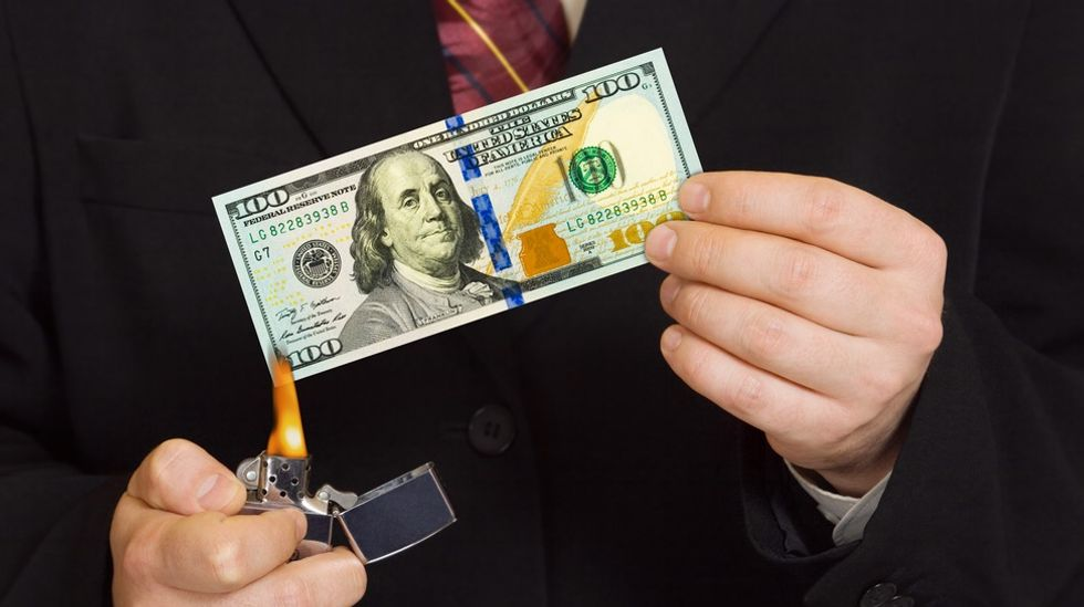 Conservative student busted taunting homeless man by lighting money on fire in front of him