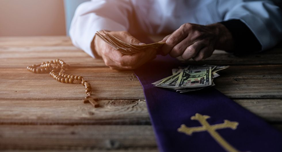 Catholic church has a secret oil money fund in West Virginia -- and one bishop is using it to pay people off