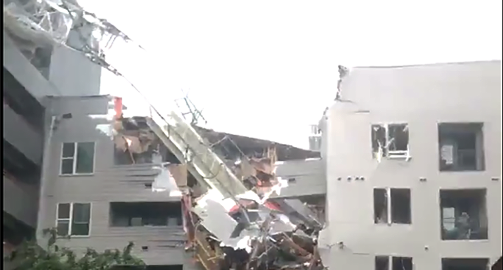 WATCH: One dead in crane collapses in Dallas -- slicing into building next to it