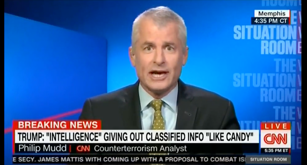'This guy has to read a book!': CNN panel erupts over Trump's attacks on the media, intel community