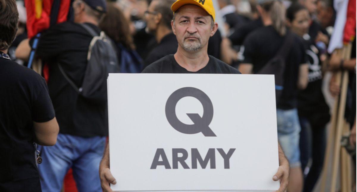 It is militia vs QAnon as Trump's extremist base splinters ahead of Biden's inauguration: report