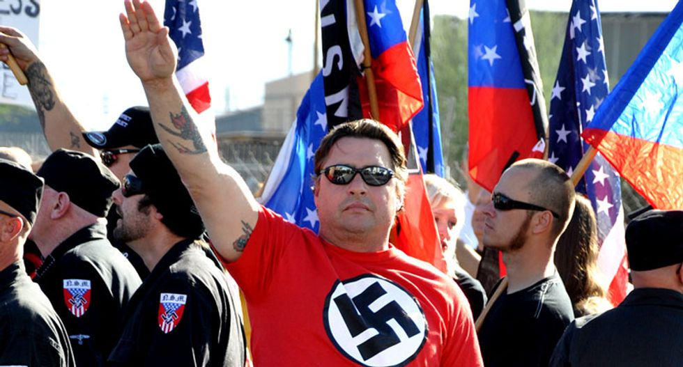 Neo-Nazi gang may get brought down because members discussed murder coverup -- on a 911 call