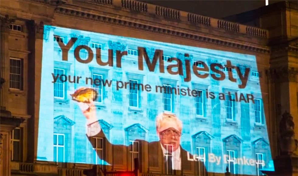 'Your new prime minister is a liar': UK's Boris Johnson greeted by massive protest projected onto Buckingham Palace