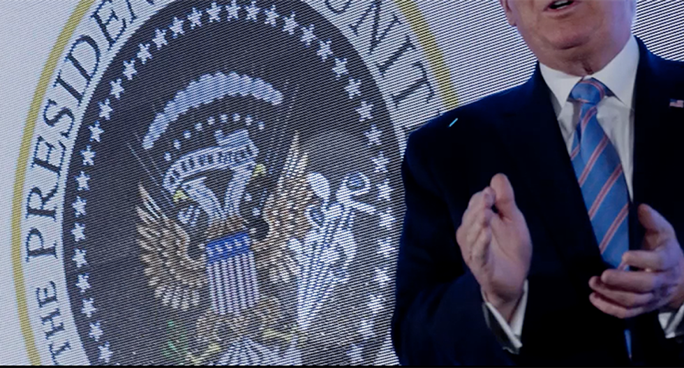 Conservative group says it has no idea how a presidential seal doctored to include a Russian symbol ended up behind Trump during his speech