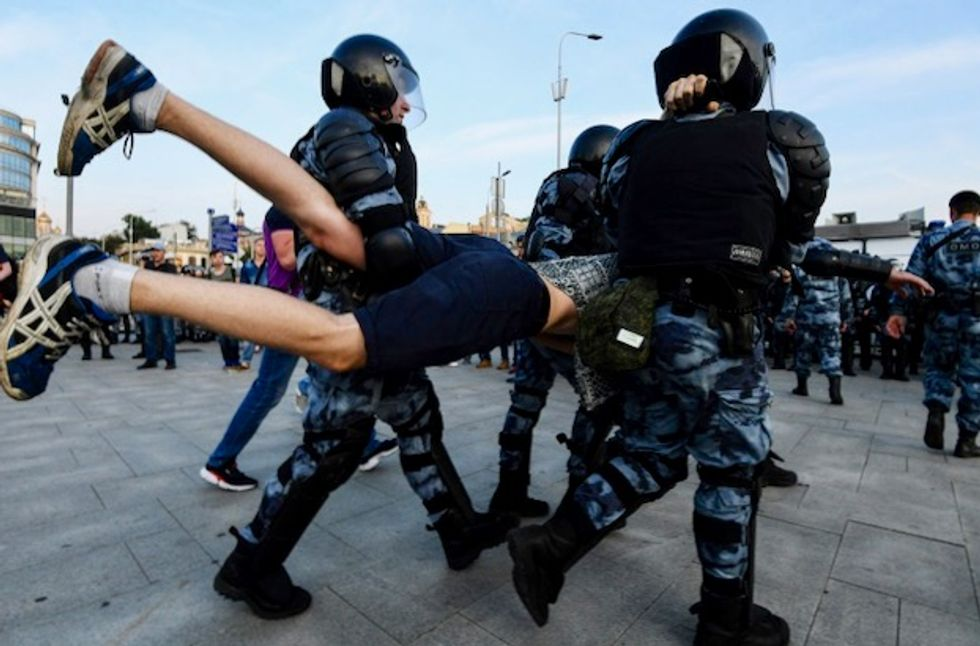 Russia launches criminal probe after mass protest for fair elections