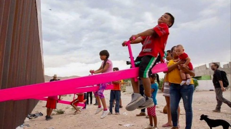 Seesaws let kids on each side of US-Mexico border play together