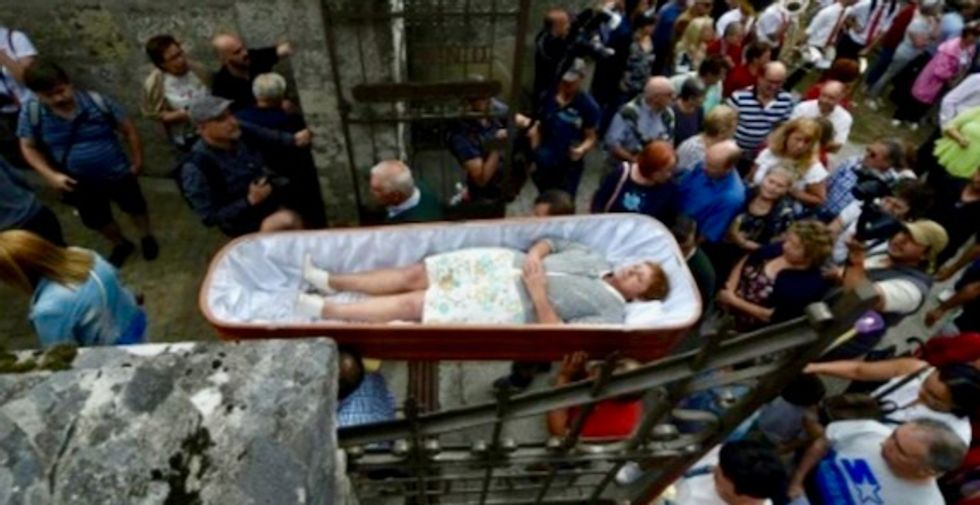 Spaniards paraded alive in coffins in gratitude for defying death