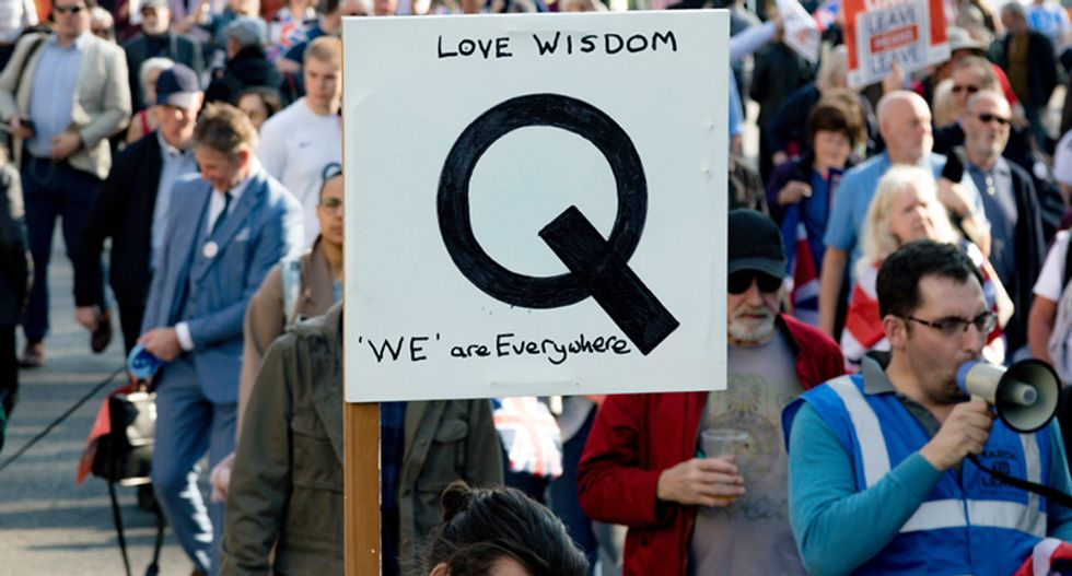 Trump can't disavow QAnon because the conspiracy movement is too deeply embedded within his base: analysis