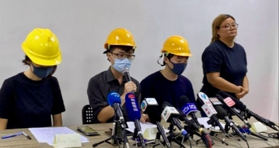Hong Kong protesters hold rare press conference as China warns not to 'play with fire'