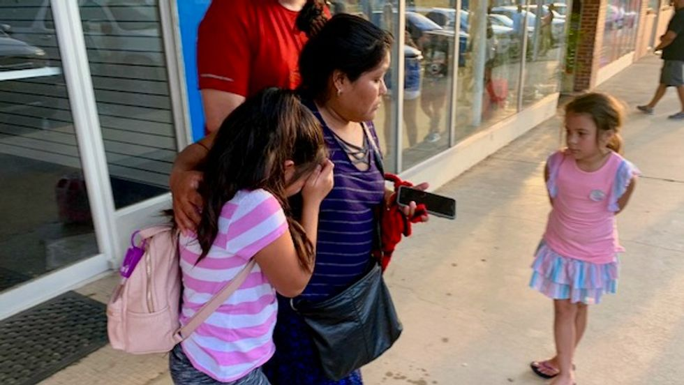 'Don't look away': Videos and images of weeping children and loved ones spread as ICE arrests 680 in Mississippi