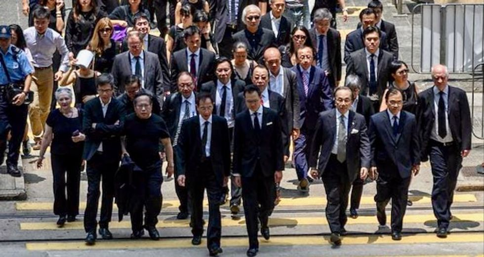 Hong Kong lawyers march in silence to support democracy protesters