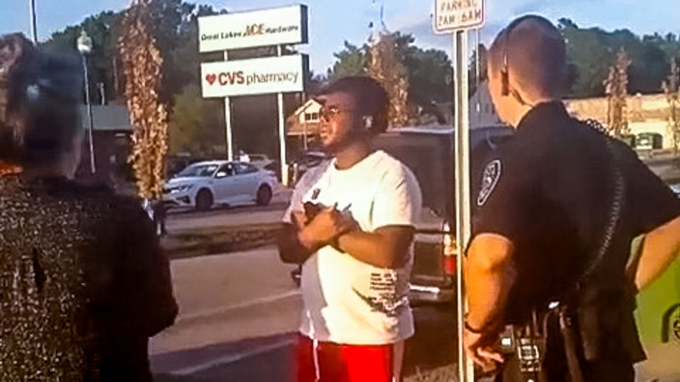 WATCH: Michigan police stop black man for 'looking suspiciously' at white woman