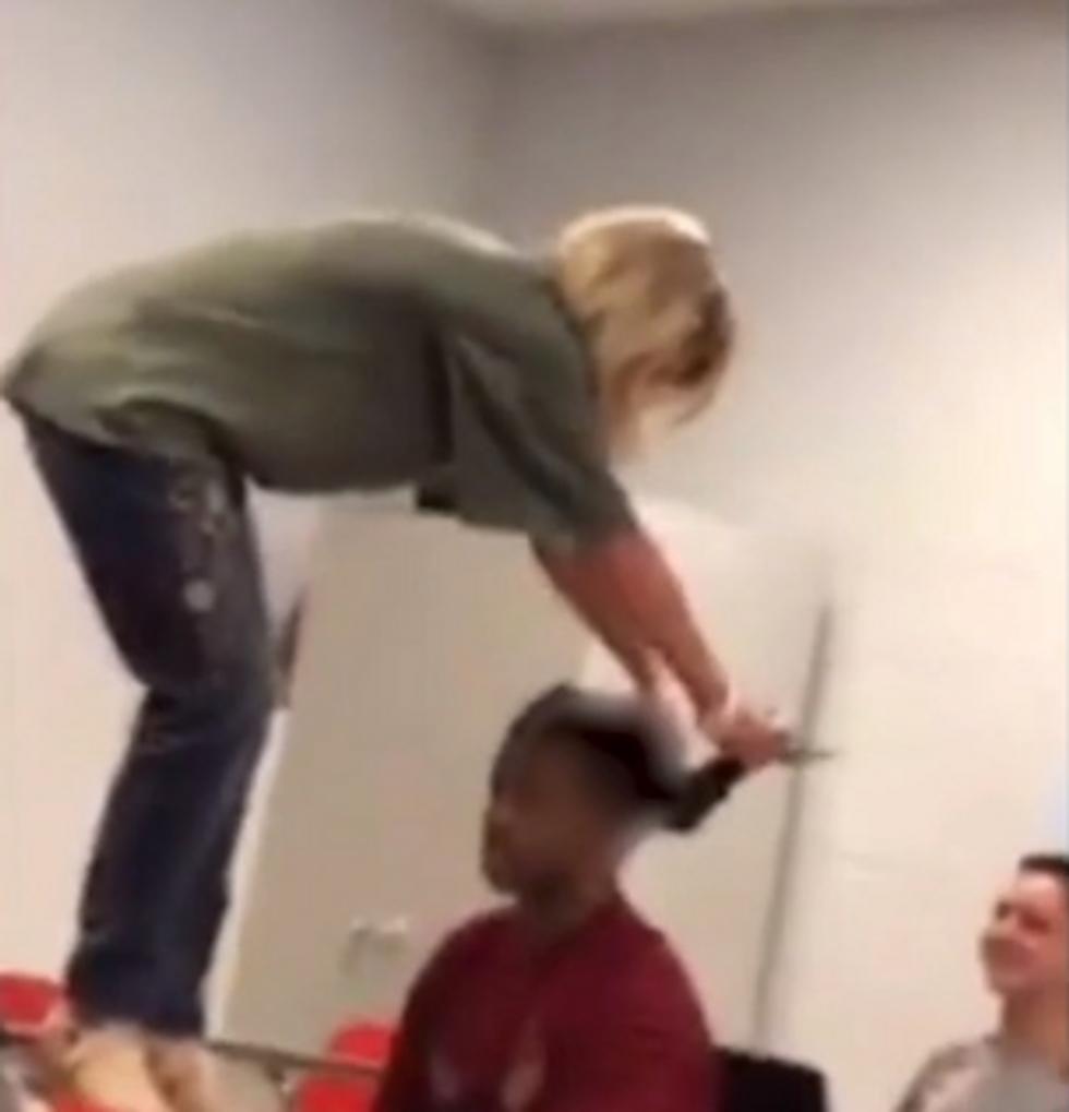 Teacher caught on video pulling black kids' dreadlocks swears it wasn't a 'malicious act'