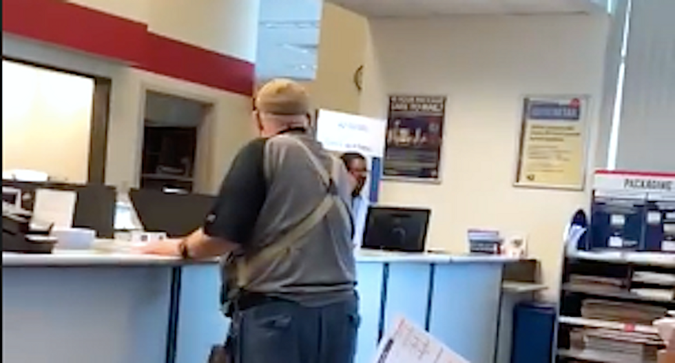 WATCH: Black postal worker stays remarkably calm as furious white man has a racist meltdown