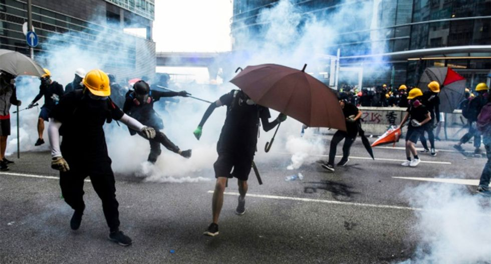 Hong Kong police threaten use of water cannon in latest clashes
