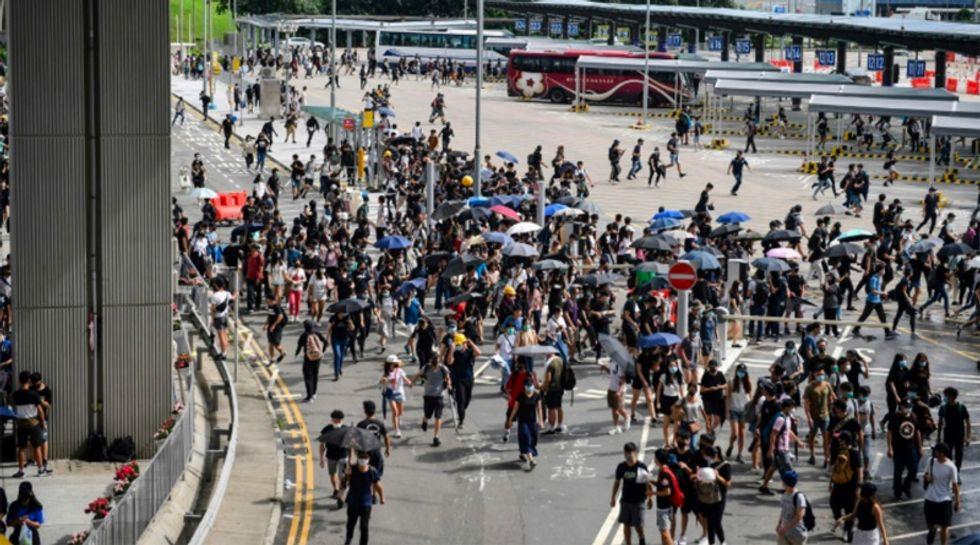 Hong Kong protesters target airport as city mops up