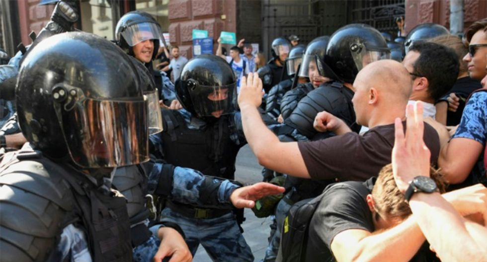 Russians go to polls after summer of protests