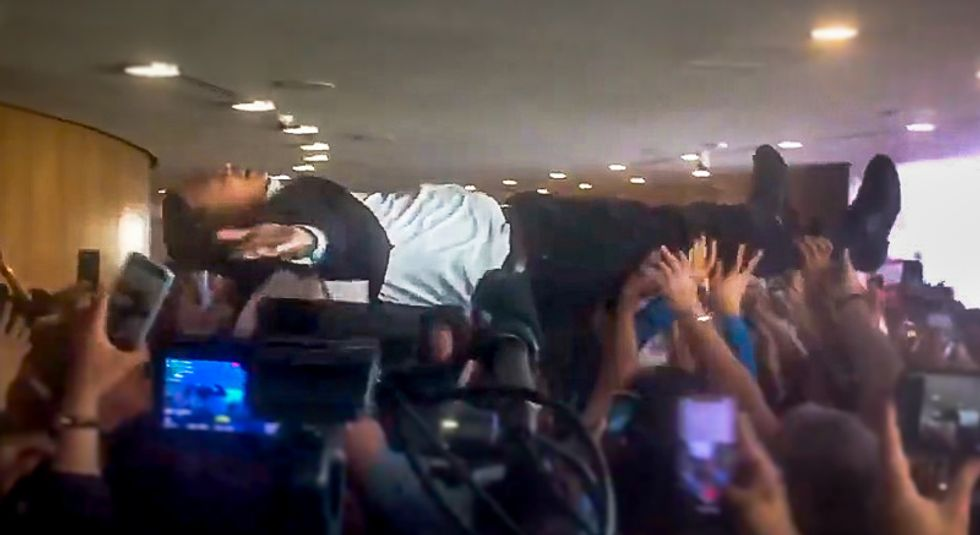Crowdsurfing video of presidential candidate Andrew Yang goes viral